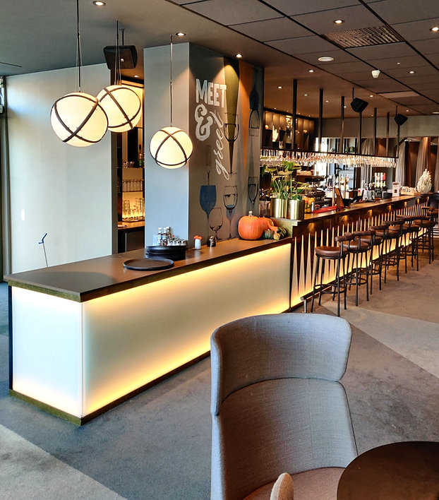 Bar desk. Made of illuminated glass, brass decorations and silestone worktop