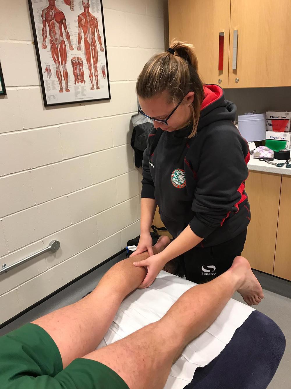 Nicole treating Harlow RUFC player
