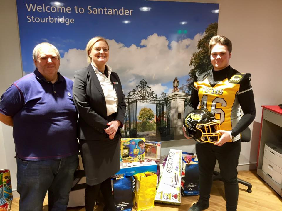 Junior team Captain Zach Jewkes and Chairman Stuart Potts-Perkins with Clare Windsor from Santander