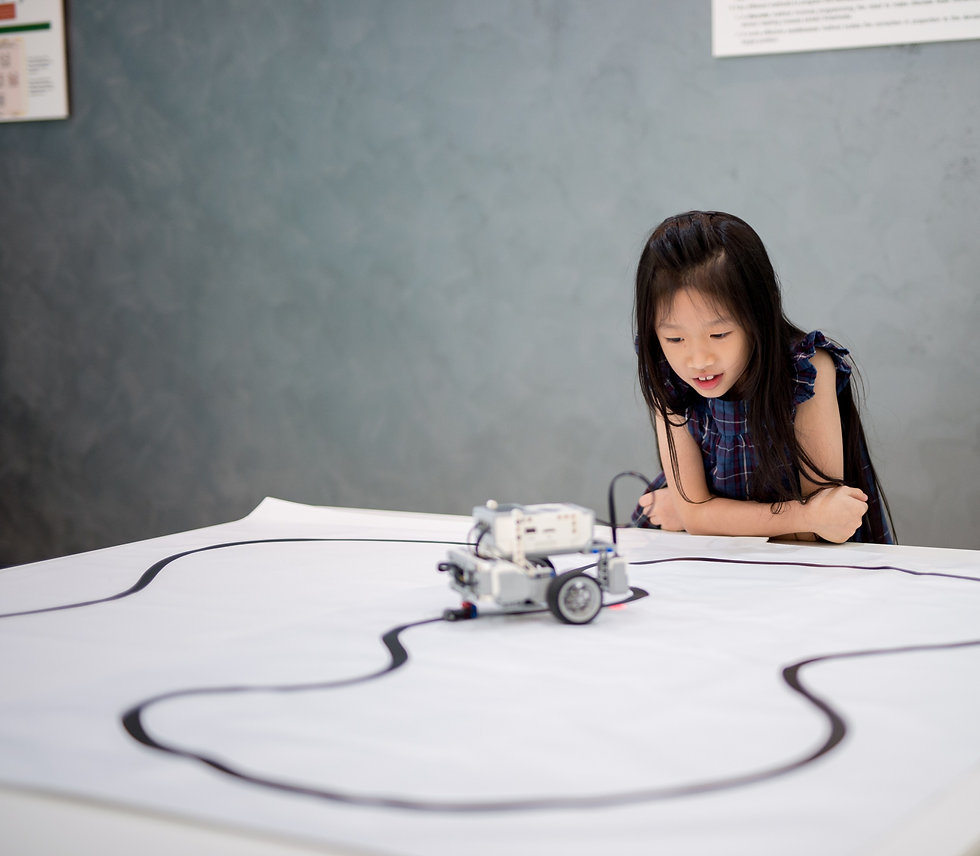 Child learning to code using EV3 Robotics
