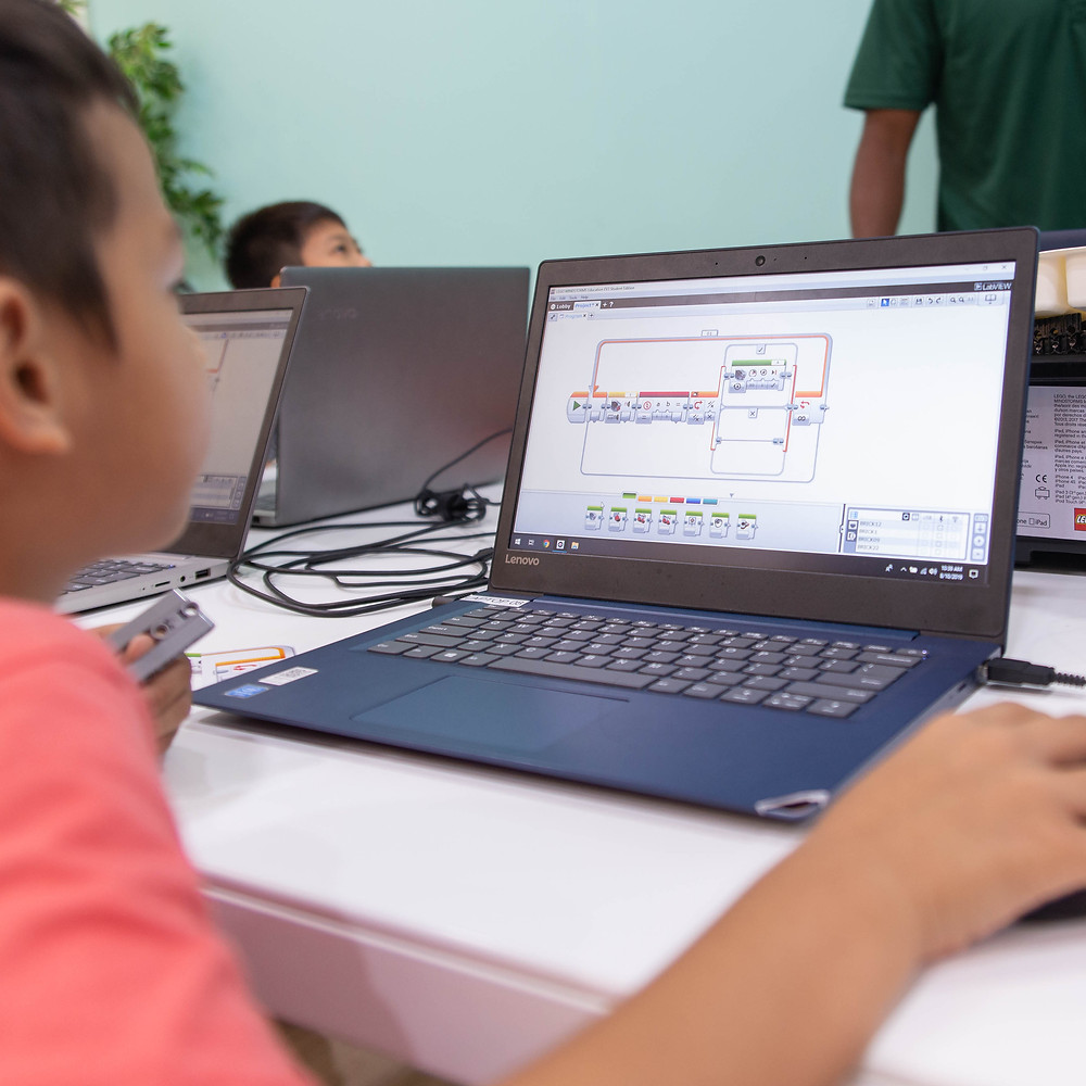 Child learning how to code using the Lego EV3 platform