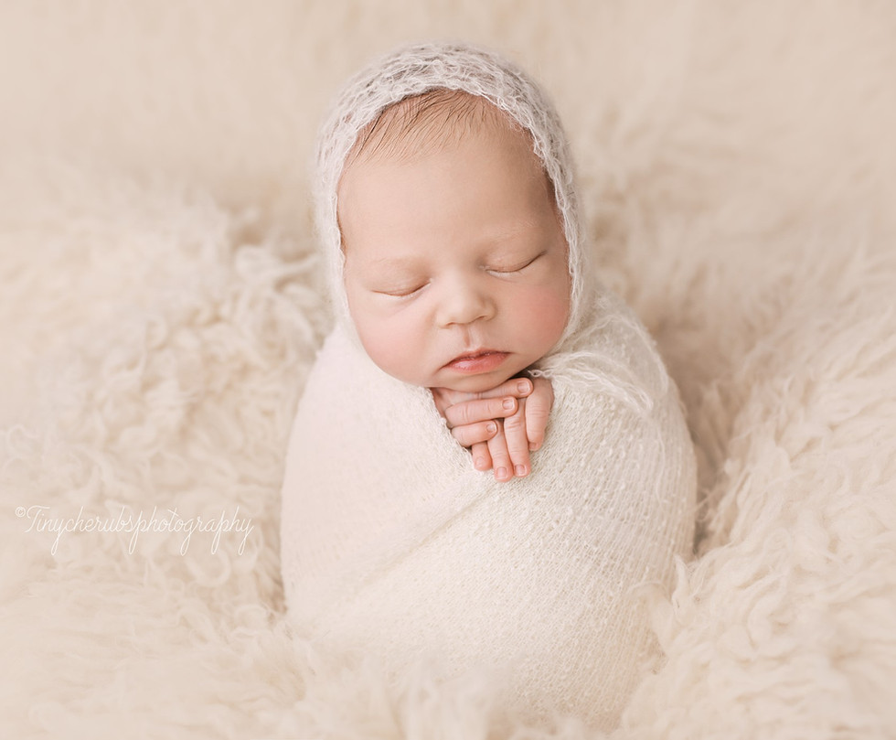 Newborn in Potato sack pose