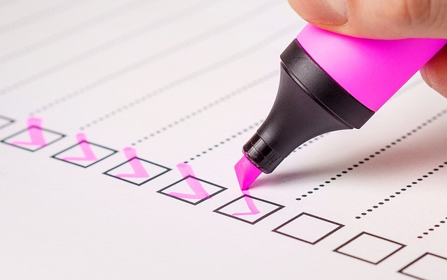 Pink highlighter checking off boxes in a list