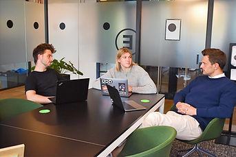 three-people-in-negotiation-room.jpg