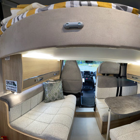 Seating area Elddis 196 with hidden bed above which can be manoeuvred.