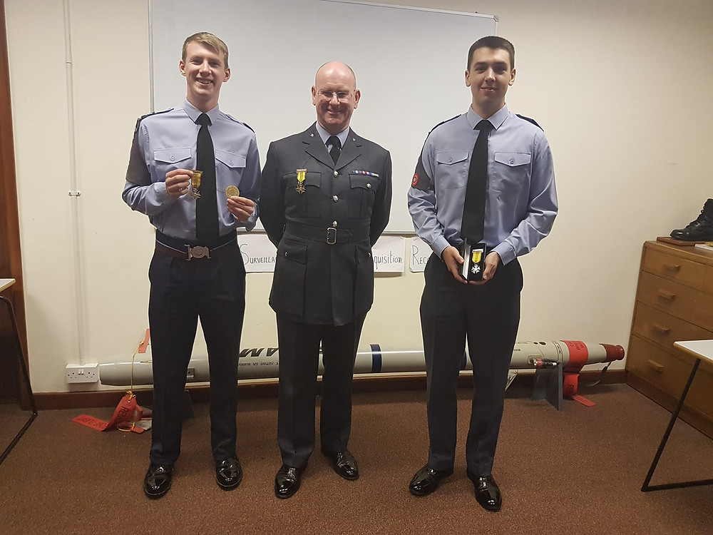 Sgt Pawson (far left) and FS Lunn (far right) receiving their Nijmegen March 2017 Medals from Wing Commander Kelly