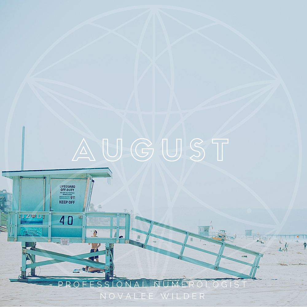 A turquoise life guard house on the beach with the word AUGUST written across in capital letters. The Numerology Forecast by Novalee Wilder