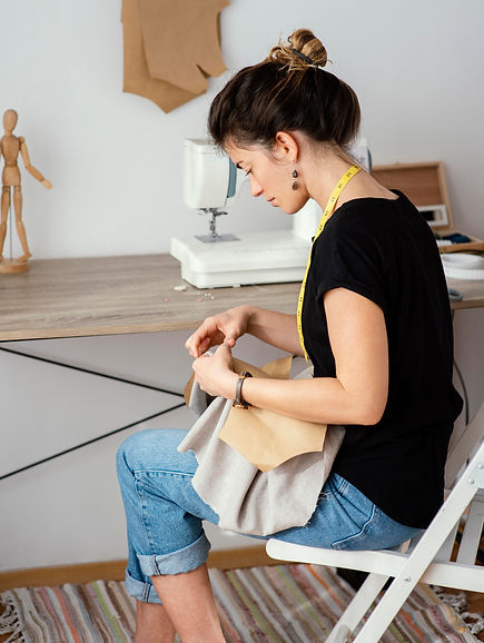 side-view-of-female-tailor-working-in-the-studio.jpg