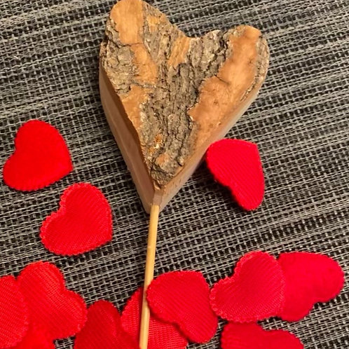 Wooden heart with wooden stick