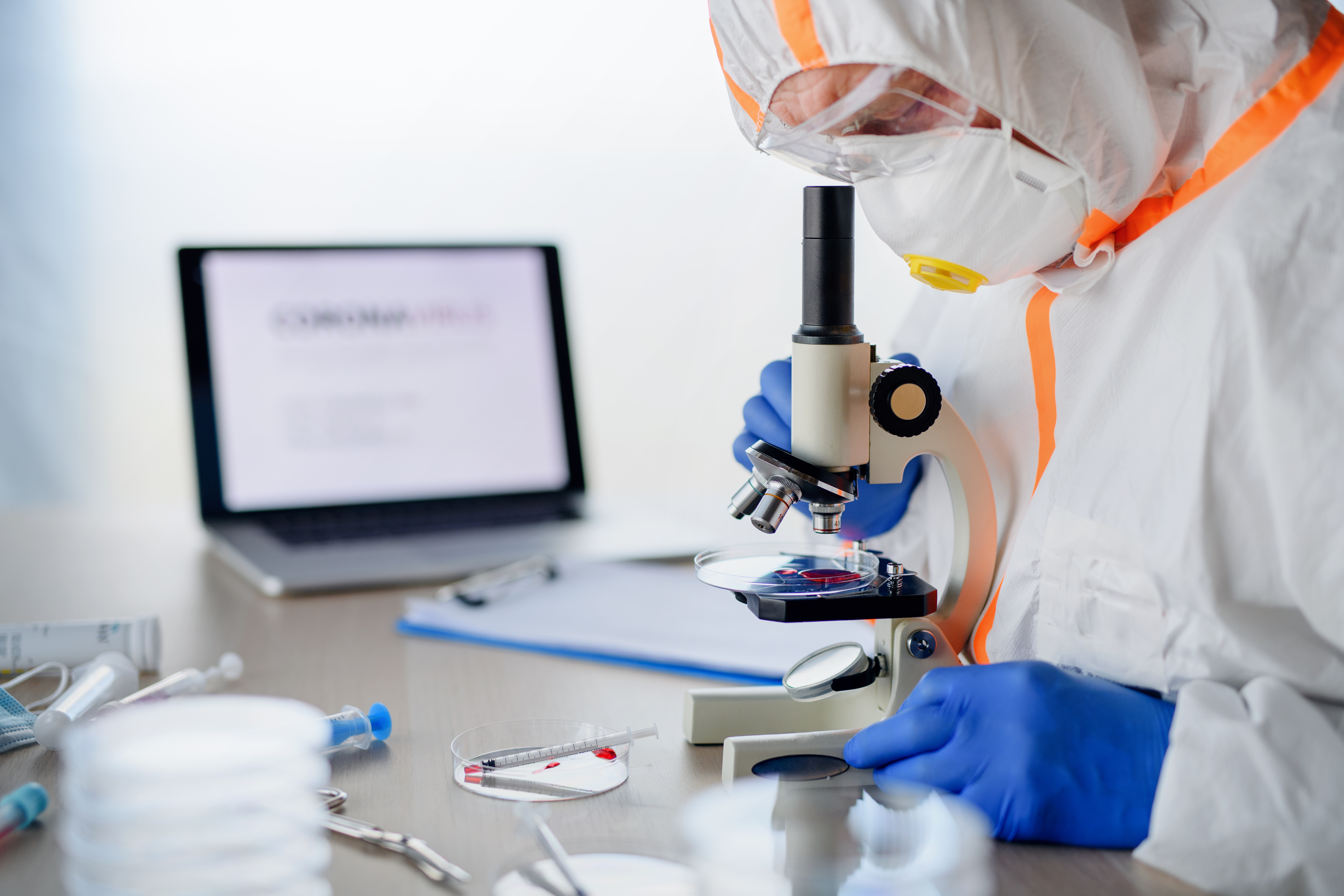 doctor-with-microscope-analyzing-blood-s