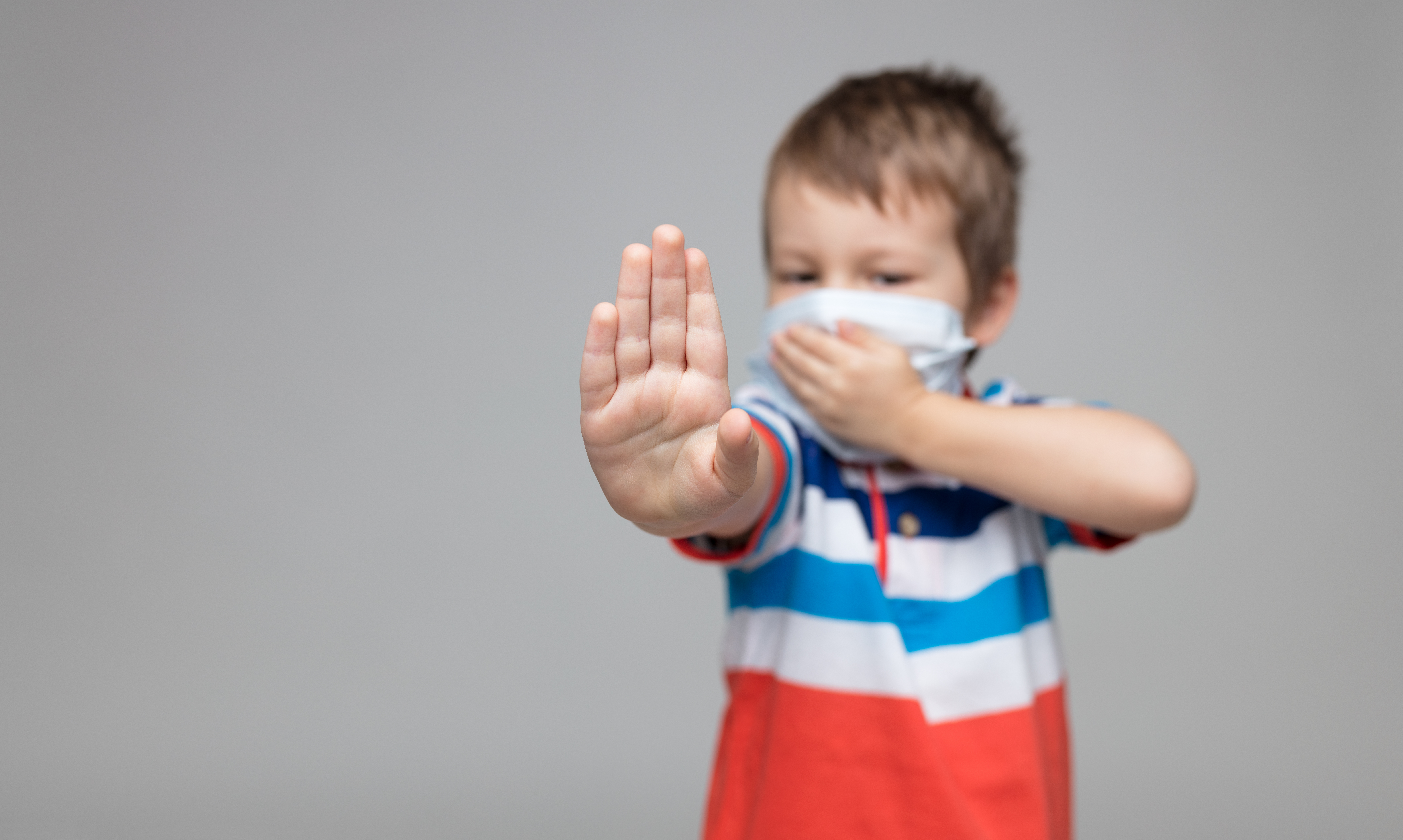 young-child-wearing-a-respiratory-mask-a