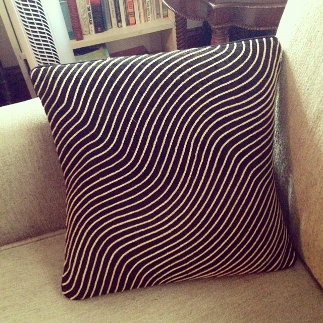 Cushion cover made in Uganda from Bark Cloth and embroidered using raffia palms.jpg