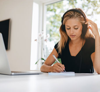 woman-studying-in-kitchen-PAZXMG6_edited