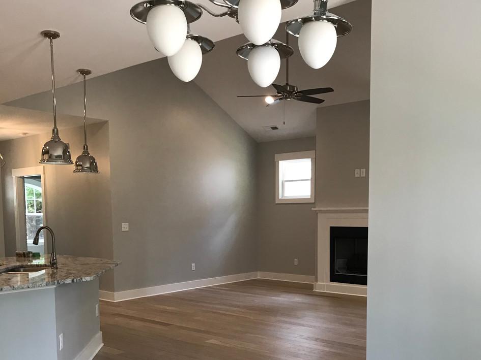 Open floor plan, wood flooring