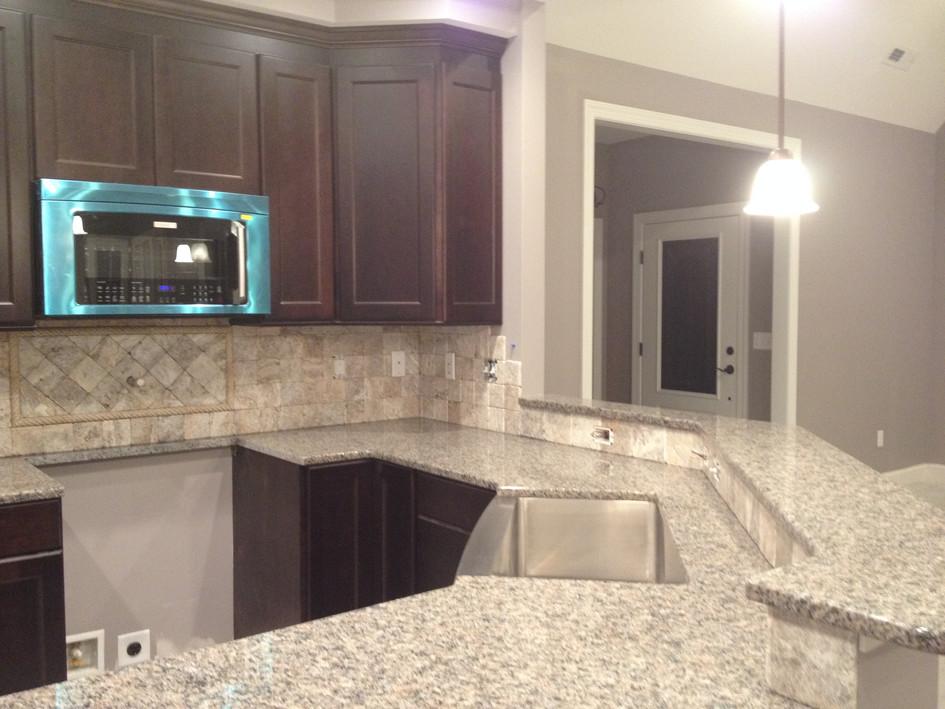 Granite counter/travertine backsplash
