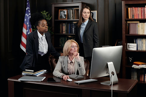businesswomen-in-an-office-looking-at-a-