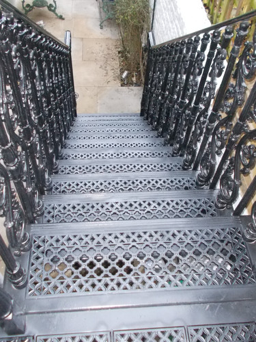 A close look at another of our popular staircase tread patterns in cast iron. Paired with one of our ornate cast iron baluster patterns.