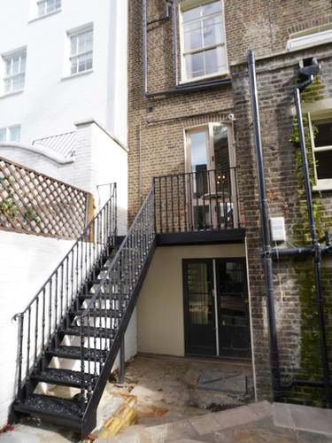 A lovely example of the elegant access our cast iron staircases can provide from French doors etc to an outdoor space. This example was in Chalcot square in London  and incorporated one of our most popular cast iron baluster patterns.