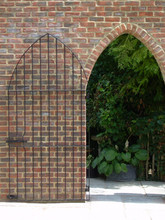 Bespoke fabricated steel gate designed to fit into archway door.