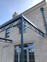 Cast iron pergola – incorporating cast pillars cast iron brackets and cast rafters.