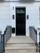 Part restored Fully installed London railings. Replacement steel uprights added and cast finials replicated and added to completely restore these original wrought iron railings in SW3.