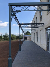 Cast iron pergola - incorporating cast pillars cast iron brackets and cast rafters