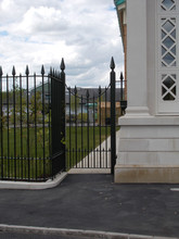 Fully installed bespoke mild steel railings with cast iron finials adoring.