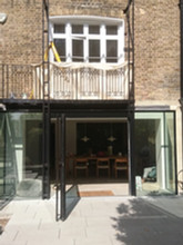 One of our classic London projects pairing the cast iron stairs and balustrade with the contemporary extension.