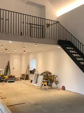 A more contemporary steel balustrade with cast iron stairs for this internal staircase.