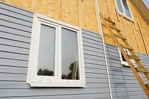 siding covering the wall of a house unde