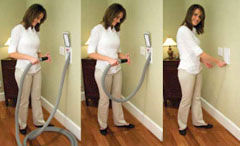 Woman usig a Hide-A-Hose central vacuum