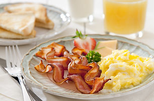 Closeup of a breakfast table with bacon,