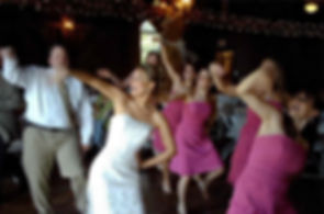Bride and her bridesmaids dancing to music of the DJ provided by Flash Jam Entertainment