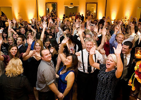 Guests at a corporate event showing theDJ how much they are enjoying the music.