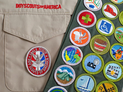 eagle-patch-and-merit-badge-sash-on-boy-