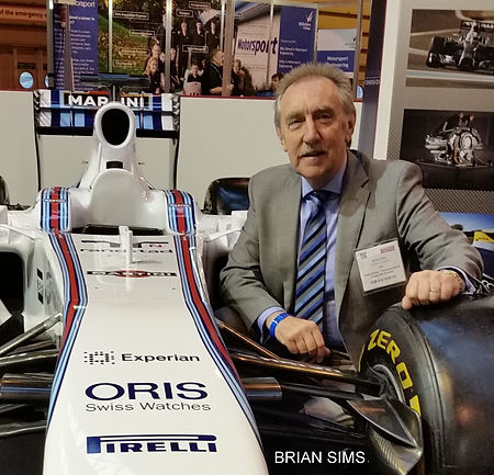 Brian Sims at the Autosport Show with the Willams F1 car in 2015.jpg