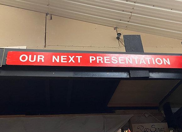 'OUR NEXT PRESENTATION' Sign