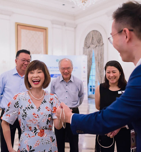 Amy Khor - Senior Minister of State, Ministry for Transport. watching Close up Magic Show
