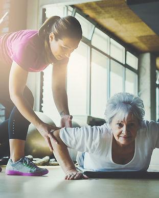 Older women doing pushups. Young persona