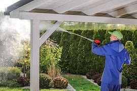 men-pressure-washing-garden-porch-wooden