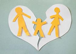 Paper cutout family split apart on a pap