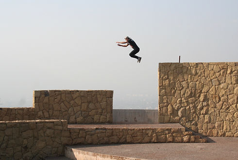Canva - Person Jumping on Beige Concrete