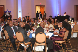 the crowd eating their meal at great futures gala