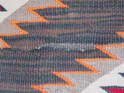 Weavers sew lines in Navajo Rugs