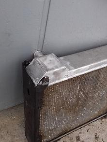 После замена пластмассовой крышки на алюминиевый
