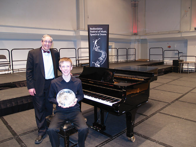 Tim Grant-Jones with his winning piano pupil at the Bedfordshire Music Festival