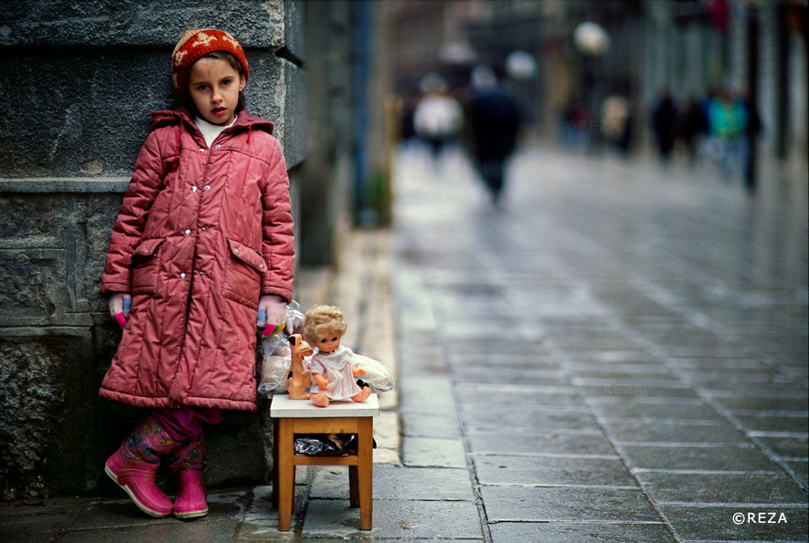 Girl Selling her Dolls