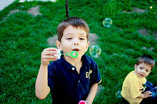 boy blowing bubbles.jpg