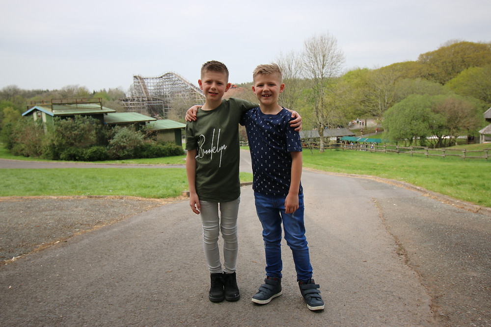 Lyall and Richard at Oakwood Theme Park with Megaphobia in the distance
