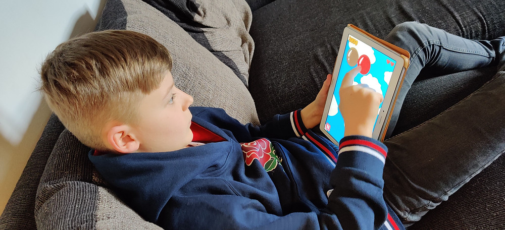 Richard's learning German via an app on the tablet